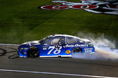 Monster Energy NASCAR Cup Series<br /> Go Bowling 400<br /> Kansas Speedway, Kansas City, KS USA<br /> Saturday 13 May 2017<br /> Martin Truex Jr, Furniture Row Racing, Auto-Owners Insurance Toyota Camry celebrates his win with a burnout <br /> World Copyright: Russell LaBounty<br /> LAT Images<br /> ref: Digital Image 17KAN1rl_5758