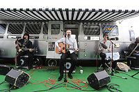 Monday 26 May 2014, Hay on Wye, UK<br /> Pictured: A small guitar band performs at the BBC radio trailer.<br /> Re: The Hay Festival, Hay on Wye, Powys, Wales UK.