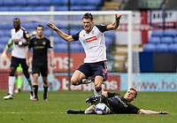 Bolton Wanderers' Ryan Delaney is fouled by Oldham Athletic's Danny Rowe<br /> <br /> Photographer Andrew Kearns/CameraSport<br /> <br /> The EFL Sky Bet League Two - Bolton Wanderers v Oldham Athletic - Saturday 17th October 2020 - University of Bolton Stadium - Bolton<br /> <br /> World Copyright © 2020 CameraSport. All rights reserved. 43 Linden Ave. Countesthorpe. Leicester. England. LE8 5PG - Tel: +44 (0) 116 277 4147 - admin@camerasport.com - www.camerasport.com