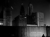 Chicago Noir: Special agent making his rounds at night at the South Water Street freight terminal of the Illinois Central Railroad. Chicago, Illinois. May 1943.<br /> <br /> Photo by Jack Delano.