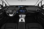 Stock photo of straight dashboard view of 2016 Toyota Prius Three Touring 5 Door Hatchback