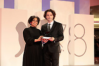"""VENICE, ITALY - SEPTEMBER 11: Directors May Abdalla and Barry Gene Murphy pose with the Grand Jury Prize for Best VR for """"Goliath: Playing With Reality"""" at the awards winner photocall during the 78th Venice International Film Festival on September 11, 2021 in Venice, Italy."""