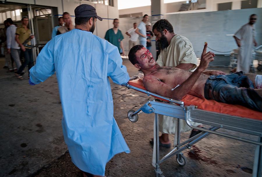 Rebel fighter casuality at Al-Zawiya Hospital, Zawiya, Libya