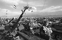 Afghan army soldiers decorate themselves and nearly 200 Soviet-built tanks near Mazar-e-Sharif on Thursday, September 14, 1989. The tanks were recently delivered across the border with the Soviet Union.
