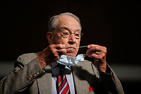 United States Senator Chuck Grassley (Republican of Iowa), puts on a face mask during a US Senate Judiciary Committee business meeting to consider authorization for subpoenas relating to the Crossfire Hurricane investigation, and other matters on Capitol Hill in Washington, Thursday, June 11, 2020. <br /> Credit: Carolyn Kaster / Pool via CNP/AdMedia