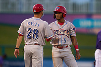 Clearwater Threshers manager Milver Reyes (28) talks with Luis García (5) during a game against the Fort Myers Mighty Mussels on May 12, 2021 at Hammond Stadium in Fort Myers, Florida.  (Mike Janes/Four Seam Images)