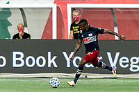 FOXBOROUGH, MA - AUGUST 29: Cristian Penilla #70 of New England Revolution dribbles at midfield during a game between New York Red Bulls and New England Revolution at Gillette Stadium on August 29, 2020 in Foxborough, Massachusetts.