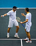 Christopher Kas of Germany and Viktor Troicki of Serbia celebrate  during the Day 7 of the PTT Thailand Open at Impact Arena on October 1, 2010 in Bangkok, Thailand. Photo by Victor Fraile / The Power of Sport Images