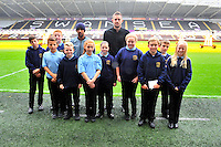 SWANSEA....<br /> WITH STORY....PREMIER LEAGUE READING STARS EVENT....<br /> THURSDAY 25th SEPTEMBER 2014<br /> Dylan Thomas School pupils pictured during the Premier League Reading Stars event at the Liberty Stadium with Gylfi Sigurdsson and Wayne Routledge.