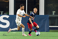 FOXBOROUGH, MA - AUGUST 5: Connor Presley #7 of New England Revolution II dribbles as Josh Coan #17 of North Carolina FC pressures during a game between North Carolina FC and New England Revolution II at Gillette Stadium on August 5, 2021 in Foxborough, Massachusetts.