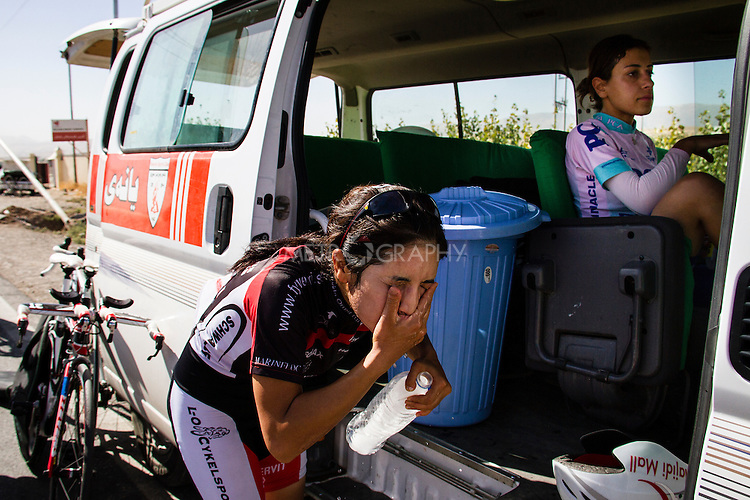 SULAIMANIYAH, IRAQ: Cyclist Nyan Yassin refreshes herself after competing in individual team time trials in temperatures of over 30ºC.<br /> <br /> Nyan Yassin, 24, is a professional competitive cyclist in Sulaimaniyah in the semi-autonomous region of Iraqi Kurdistan.  She is the captain of an all-female club called Newroz Club, which is the only cycling club for women in Sulaimaniyah, although there are other clubs around Iraq.  She trains and competes on roads that are badly surfaced and busy with traffic.<br /> <br /> Nyan was the first woman to start cycling in Sulaimaniyah.  She was always competitive and after trying her hand at different sports she settled on cycling.  She is now the top female cyclist in Iraq.  Her nickname is MigMig after the noise made by the cartoon character Roadrunner.<br /> <br /> Despite being clearly talented at her sport Nyan knows that in a couple of years she will have to get married and then abandon it as, in the traditional society that Kurdistan is, being a wife and a competitive sportswoman at the same time is not an option.<br /> <br /> Photo by Gona Hassan/Metrography