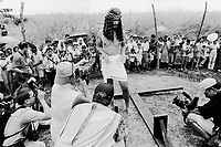 Philippines. Luzon island. San Fernando, Pampanga.70 km from Manila. Crucifixions at Easter on Good Friday. A man wears a cloth around his waist. He is half naked. He will be nailed to a wood cross as a representation of Jesus on the cross. The man shows his hands  to the media (television and photographers) before the event takes place.  © 1999 Didier Ruef