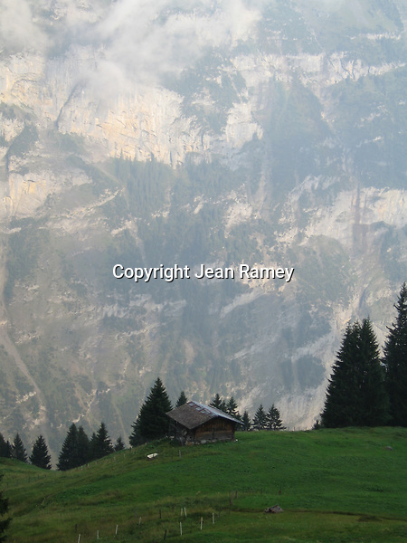 Birds Eye View. An alpine cottage overlooks the North Face of the Swiss Alps