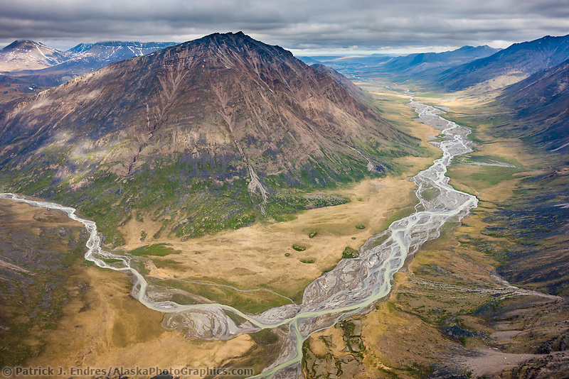 Okokmilaga river flows north out of the Brooks Range mountains, through the Gates of the Arctic National Park, Alaska.