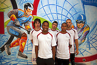 Switzerland. Canton Ticino. Tenero. Centro Sportivo Nazionale della Gioventù - Tenero (CST). Nationales Jugendsportzentrum Tenero. From left to right: Lucio Romero, Killian Imwinkelried, Bastien Mouthon, Yanier Bello and  Alain Enz are the swiss team for the 4 × 100 metres relay. The sprint relay is an athletics track event run in lanes over one lap of the track with four runners completing 100 meters each. Drawings on the wall of a ice hockey player and a skier. 31.05.11 © 2011 Didier Ruef