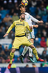 Cristiano Ronaldo (R) of Real Madrid competes for the ball with Alvaro Gonzalez Soberon of Villarreal CF during the La Liga 2017-18 match between Real Madrid and Villarreal CF at Santiago Bernabeu Stadium on January 13 2018 in Madrid, Spain. Photo by Diego Gonzalez / Power Sport Images