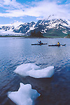 Kayaking, Alaska, Kenai Fjords National Park, Aialik Bay, Sea kayakers launch amidst bergy bits (small ice bergs), Elliot Marks, David Fox, model released, Feathercraft breakdown sea kayaks,.