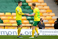 20th March 2021; Carrow Road, Norwich, Norfolk, England, English Football League Championship Football, Norwich versus Blackburn Rovers; Kenny McLean of Norwich City celebrates with Oliver Skipp after he scores for 1-0 in the 53rd minute