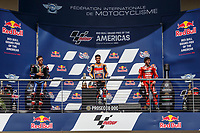 3rd October 2021; Austin, Texas, USA; Winners on the podium- Marc Marquez (93) - (SPA) 1st place, Fabio Quartararo (20) - (FRA) in 2nd place and Francesco Bagnaia (63) - (ITA) in 3rd place after the MotoGP Red Bull Grand Prix of the Americas