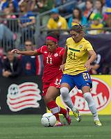 Canadian midfielder Desiree Scott (11) dribbles as Brazilian player Gabriella Demoiser (21) pressures. In an international friendly, Canada defeated Brasil, 2-1, at Gillette Stadium on March 24, 2012.