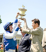 Carl Rafter and Todd McKenna hugh-five each other after Meet At Eleven wins the Radnor Hunt Cup.