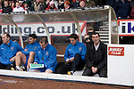 Nottingham Forest 2 Ipswich Town 0, 23/10/2010. City Ground, Championship. Ipswich Town manager Roy Keane sitting in the away dugout at the City Ground, Nottingham before Nottingham Forest take on visitors Ipswich Town in an Npower Championship match. Forest won the match by two goals to nil in front of 22,935 spectators. Photo by Colin McPherson.