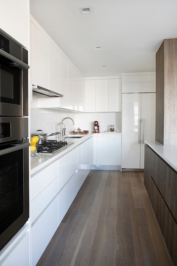 Contemporary kitchen with white cupboards