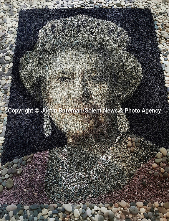 Pictured: Justin Bateman's portrait of The Queen made from pebbles<br /> <br /> A British artist stuck in Thailand has spent his time constructing masterpieces from pebbles for locals to enjoy.  Justin Bateman had only planned on staying in Chiang Mai for a week - but has remained there now for nearly ten months after the pandemic struck. <br /> <br /> His pebble portraits include The Queen, Spanish painter Pablo Picasso, Michelangelo's David and a local farmer - who was bemused by his portrait.   Mr Bateman, from Portsmouth, Hants, was staying in Bali when he travelled to Chiang Mai, in Thailand, to visit some friends.   SEE OUR COPY FOR DETAILS.S.<br /> <br /> Please byline: Justin Bateman/Solent News<br /> <br /> © Justin Bateman/Solent News & Photo Agency<br /> UK +44 (0) 2380 458800