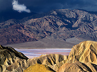 Colorful rock formations and storm as seen from Golden Canyon Trail. Death Valley National Park, California