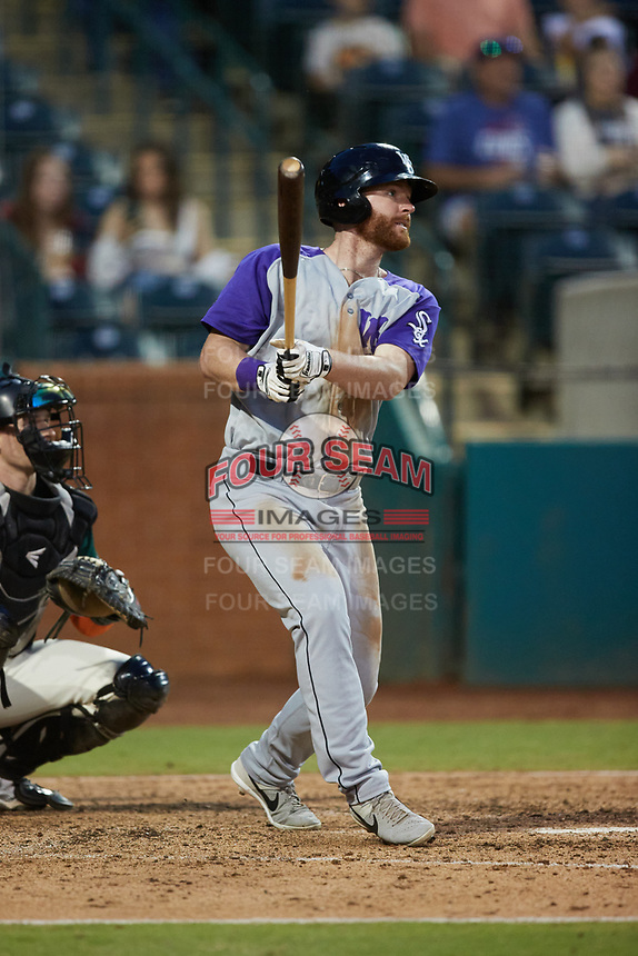 Alex Destino (23) of the Winston-Salem Dash follows through on his swing against the Greensboro Grasshoppers at First National Bank Field on June 3, 2021 in Greensboro, North Carolina. (Brian Westerholt/Four Seam Images)
