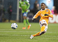 Houston Dynamo midfielder Corey Ashe takes a shot on goal during play against the Seattle Sounders FC at Qwest Field in Seattle Friday March 25, 2011. The match ended in a 1-1 draw.