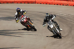 Carey Hart (46) and Chris Filmore Jr. (11) compete during the Moto X Super Moto final during X-Games 12 in Los Angeles, California on August 6, 2006.