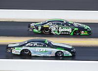 Sep 18, 2016; Concord, NC, USA; NHRA pro stock driver Kenny Delco (near) races alongside Alex Laughlin during the Carolina Nationals at zMax Dragway. Mandatory Credit: Mark J. Rebilas-USA TODAY Sports