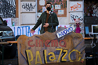 """University Students Representative.<br /> <br /> Rome, 03/12/2020. Today, the Nuovo Cinema Palazzo Community held a second public assembly (1.) in Rome's San Lorenzo district to protest against the eviction of the """"Nuovo Cinema Palazzo"""" completed by the Italian police forces in the early morning of the 25th of November and to demonstrate against the violent reaction of the Police forces when, in the evening of the same day, a large demo asked to have the chance to hold a public assembly in the square (Piazza dei Sanniti) of the cinema (2.). The public assembly of today saw the participation and the support & solidarity of the representatives of movements, actors, musicians, students, artists, politicians, and citizens of San Lorenzo who told their stories and memories related to the famous Rome's Art and culture occupation (For example, actor Marcello Fonte, Best Actor Award of the 2018 Cannes Film Festival for the film Dogman, was among the first group of occupiers of the Nuovo Cinema Palazzo). The assembly of the 1st December was interrupted due to the bad weather (3).<br /> The Nuovo Cinema Palazzo was occupied the 15th of April 2011, when citizens, movements, workers of the entertainment industry reopened the former """"Palazzo Cinema"""" to prevent the opening of a casino/gambling space. The illegal occupation was intended as a public hub of art, culture, sport and politics, an open place for exchange, discussion, studies, caring and sharing.<br /> <br /> Footnotes & Links:<br /> 1. http://bit.do/fLCpE<br /> 2. Demo And Clashes Against Nuovo Cinema Palazzo Eviction in Rome's San Lorenzo: http://bit.do/fLxgz<br /> 3. http://bit.do/fLCr3<br /> Previous Stories about Nuovo Cinema Palazzo: 14.04.2018 - Nuovo Cinema Palazzo's Concert: """"7 Anni di CasiNò 