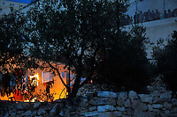 Rioting Jewish settler youths attack a Palestinian house, setting it alight. Violence erupted as the Israeli army evicted a group of settlers from a disputed building in Hebron. The Israeli high court had rejected the settlers' claim that they legally bought the house from its Palestinian owner. As the house became a symbol of defiance, the few families living there were joined by a mob of some 1,500 radical right-wing youths, who went on a rampage and attacked Palestinians in the mixed West Bank city.