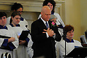 Mayor Mitch Landrieu gets ready to sing Ave Maria as Family, friends and well-known politicians say goodbye to former US Rep. Lindy Boggs during her funeral at St. Louis Cathedral, New Orleans, Aug. 1, 2013.