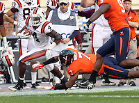 CHARLOTTESVILLE, VA- NOVEMBER 12: Running back David Wilson #4 of the Virginia Tech Hokies is tackled by safety Corey Mosley #7 of the Virginia Cavaliers and linebacker LaRoy Reynolds #9 of the Virginia Cavaliers during the game on November 28, 2011 at Scott Stadium in Charlottesville, Virginia. Virginia Tech defeated Virginia 38-0. (Photo by Andrew Shurtleff/Getty Images) *** Local Caption *** David Wilson;Corey Mosley;LaRoy Reynolds