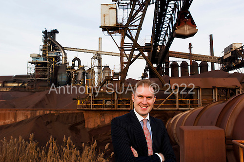 """Dearborn, Michigan<br /> USA<br /> February 16, 2011<br /> <br /> Sergei A. Kuznetsov, chief executive officer of Severstal North America in front of the old (left) and new """"C"""" blast furnaces. <br /> <br /> The former Ford Rouge Steel Plant completed in 1928 is now owned, run and being renovated and expanded by Russian owner """"Severstal North America"""". This is one of five steel plants owned by Severstal in the United States and they are spending huge sums to convert it into what could be the continent's most efficient automotive steel plant.<br /> <br /> Rouge Steel fell on hard times after Ford Motor Company spun it off in 1989 into an independent steel company. <br /> <br /> After buying the assets of the bankrupt company for USD 280 million, Severstal spent USD 350 million to repair one of the blast furnaces. The company built a new cold-rolling line which converts steel slabs into sheet metal. And it added a galvanizing line which coats sheet metal with zinc for rust-resistant body panels.<br /> <br /> The operation assets and improvements amount to USD 1.4 billion. Add in spending on a new mini mill in Columbus, Mississippi a USD 1.6 billion operation and Severstal has placed a USD 3 billion bet on North America auto industry.<br /> <br /> Mr Kuznetsov said """"The auto industry will have to meet tough fuel efficiency standards and weight is a big issue. Vehicles have to be lighter and I think this is going to be a big play for the industry."""""""