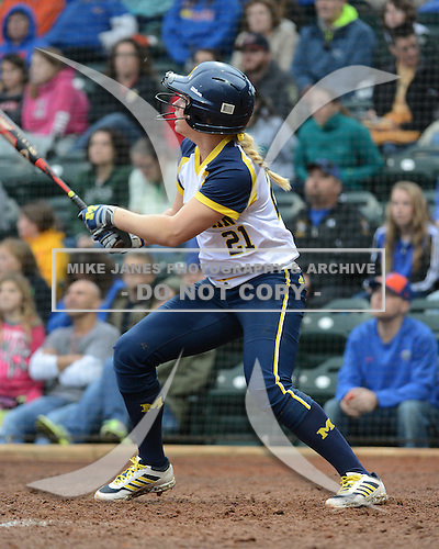 Michigan Wolverines outfielder Kelly Christner (21) at bat during the season opener against the Florida Gators on February 8, 2014 at the USF Softball Stadium in Tampa, Florida.  Florida defeated Michigan 9-4 in extra innings.  (Copyright Mike Janes Photography)