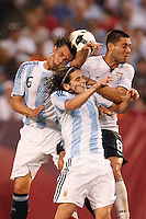 Argentina defender Gabriel Heinze (6) and defender Gabriel Heinze (6) battle United States midfielder Clint Dempsey (8) for a header. The men's national teams of the United States and Argentina played to a 0-0 tie during an international friendly at Giants Stadium in East Rutherford, NJ, on June 8, 2008.