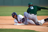 Brevard County Manatees Jose Cuas (1) slides into third covered by Ty Washington (3) during a game against the Daytona Tortugas on August 14, 2016 at Space Coast Stadium in Viera, Florida.  Daytona defeated Brevard County 9-3.  (Mike Janes/Four Seam Images)