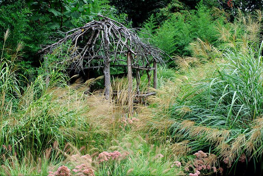 Garden with brush gazebo and ornamental grasses #5610. Virginia.