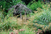 Garden with brush gazebo and ornamental grasses #5610. Virginia.