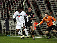 Pictured L-R: Jason Scotland of Swansea tries to monoevre himself away from Stephen Wright of Coventry City (C) while goalkeeper for the latter Keiren Westwood is keeping on his guard.<br /> Re: Coca Cola Championship, Swansea City FC v Coventry City at the Liberty Stadium. Swansea, south Wales, Friday 26 December 2008.<br /> Picture by D Legakis Photography / Athena Picture Agency, Swansea 07815441513