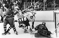 Darryl Sittler looks the other way as Borje Salming takes an unscheduled trip<br /> <br /> Bezant, Graham<br /> Picture, 1978,<br /> <br /> 1978<br /> <br /> PHOTO : Graham Bezant - Toronto Star Archives - AQP