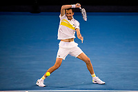 21st February 2021, Melbourne, Victoria, Australia; Daniil Medvedev of Russia returns the ball during the Men's Singles Final of the 2021 Australian Open on February 21 2021, at Melbourne Park in Melbourne, Australia.