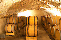 The vaulted barrel aging cellar with oak barriques.  Domaine Eric et Joel Joël Durand, Ardeche, Ardèche, France, Europe