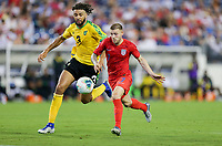 NASHVILLE, TENN - JULY 03: Paul Arriola #7, Michael Hector #3 during a 2019 CONCACAF Gold Cup Semifinal match between the United States and Jamaica at Nissan Stadium on July 03, 2019 in Nashville, Tennessee.