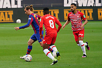 29th April 2021; Camp Nou, Barcelona, Catalonia, Spain; La Liga Football, Barcelona versus Granada; Antoine Griezmann Barcelona forward goes past Yan Eteki of Granada CF