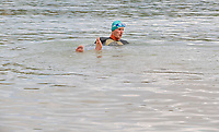 BNPS.co.uk (01202) 558833. <br /> Pic: CorinMesser/BNPS<br /> <br /> WITH VIDEO... https://we.tl/t-pi2ICf3bFT<br /> <br /> Pictured: Oly is training to swim around the Isle of Wight <br /> <br /> This is the terrifying moment a man found himself surrounded by 50 sharks in British waters while training to swim around the Isle of Wight. <br /> <br /> Oly Rush set off from the exclusive Sandbanks resort, Dorset, for his first night time swim in preparation for the charity challenge. <br /> <br /> He cut through the pitch black waters, unable to see more than a few metres ahead of him, until something knocked him about 240ft from shore. <br /> <br /> Stopping alongside Ashley McPherson, who accompanied him in a kayak, unknown creatures continued to buffer at his legs near Branksome Beach, Poole. <br /> <br /> Unnerved, Oly, 36, dived beneath the surface with his phone in a waterproof case while Ashley pointed his torch.